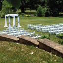 White garden chairs arranged for a wedding.