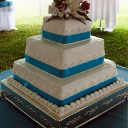 A white three-tiered accented with Tiffany blue ribbons.