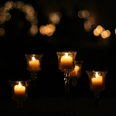 Candle centerpieces in a pitch black room.